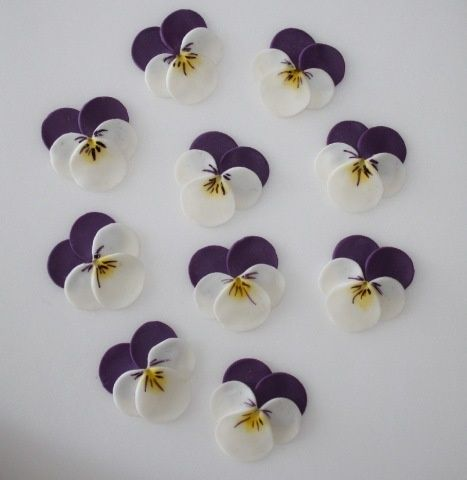 pansies made with circle punch. How pretty are these and a simple circle punch is all you appear to need. More
