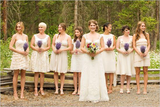 Cream bridesmaid dresses with lavender bouquets