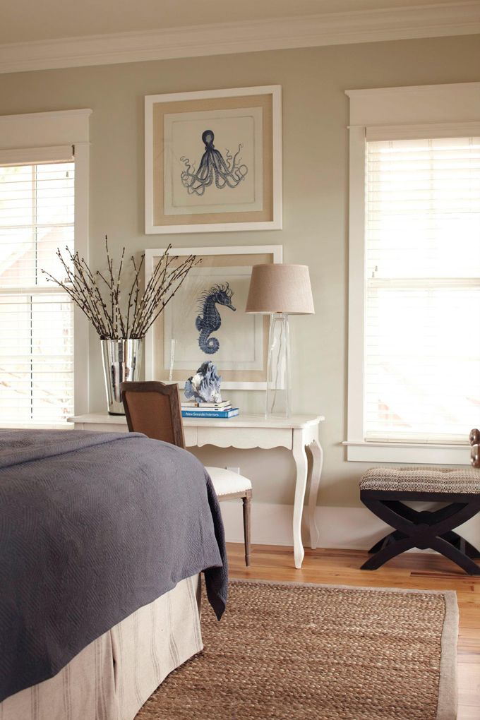I love the jellyfish and seahorse prints on the wall! A little whimsical, great color, nicely framed in neutrals on neutral wall.