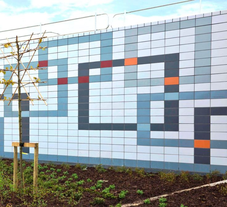 Humberside Divisional Police Headquarters, Hull.  An artist designed patterned wall, created using various colours of Glazed Fireborn large format bricks, forms an attractive public plaza to the building's entrance elevation.