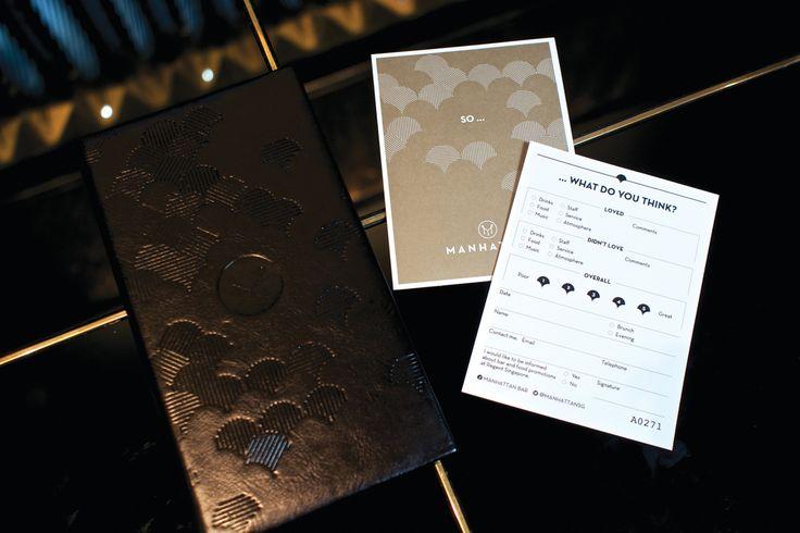 There Design-  Branding/Menu Design for Manhattan- Four Seasons Hotel- Singapore.  http://there.com.au/work/Manhattan