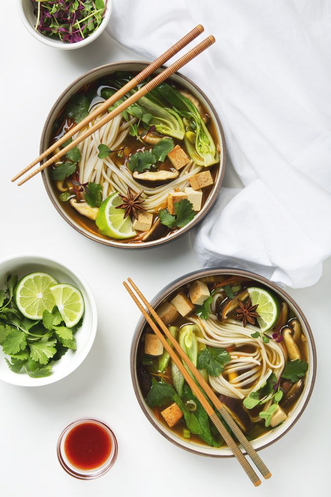 Easy Vegan Pho made from simple ingredients, ready in 30 minutes! Top with baked tofu for protein, bean sprouts, fresh lime, and sriracha for heat.