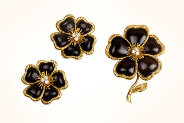 A beautiful vintage Van Cleef and Arpels flower set featuring a brooch and earrings.