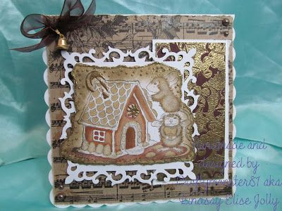 For this weeks card I decided to use a House Mouse stamp (surprise surprise lol), I have coloured it in with fleximarkers, inked the edges with distress ink and used a glue pen and embossing powder from Kirsten Lapping Designs to highlight the edges of the image and a couple of the sweets on the gingerbread house. The background is a paper from the Tim Holtz Christmas Kraft paper pack and then I have used a holly background stamp from All Night Media on to a scrap of mount board and embossed…