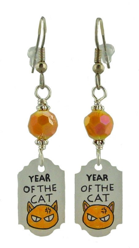 Fruits Basket inspired earrings, year of the cat. If you look closely Kyo (the cat) is mad, because well that was his state at least 90% of the time; the rest of the time was surly, annoyed or depress