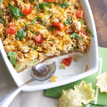 Tex-Mex Taco Dip  Ready in just under an hour, this colorful party appetizer adds avocados, fresh spinach, and cream cheese to your typical taco dip. It's served best with scooped tortilla chips or vegetable dippers.