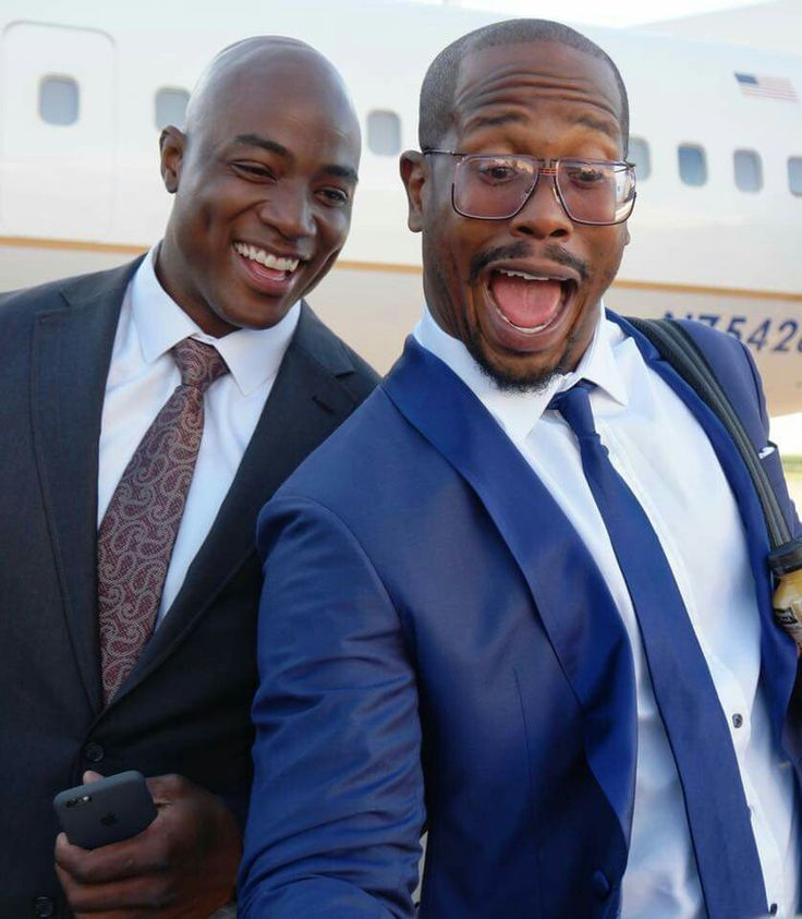 DeMarcus Ware and Von Miller pose for selfies on their way to meet the President.