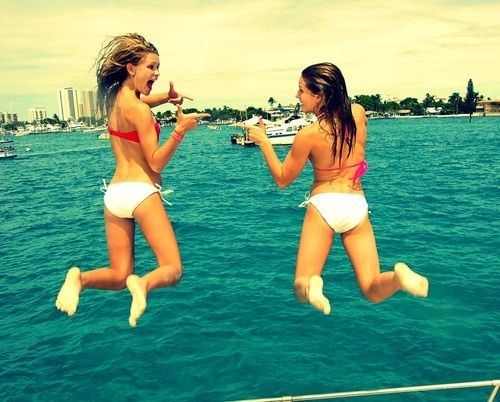 Get your friend to jump with you at the same time and do a fun pose before you land in the water!!(: Its fun!