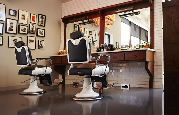 Two barbering chairs oak stations and American Crew