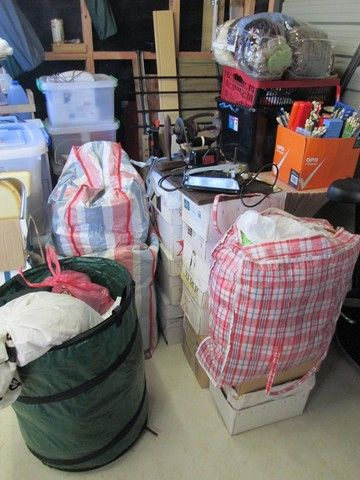 Donations for the hospice stall have started to come in! The striped bags are stuffed full of dyed sliver, natural sliver and fleece.  The green 'barrel' is full of yarn.  The boxes on the floor contain many years of Stitchcraft magazine, going back to the 1950's – really vintage stuff!