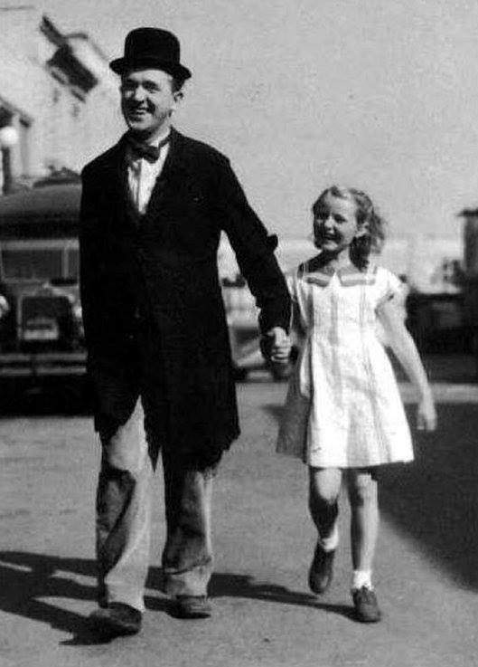 Comedy icon Stan Laurel walks his daughter Lois through the studio.