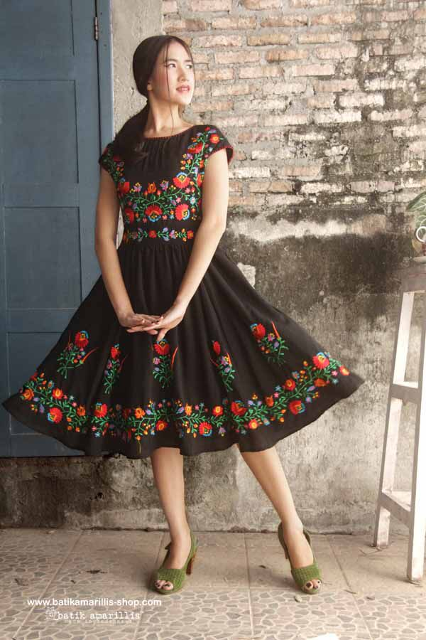 Our Iconic Series..hey day dress is back!! Batik Amarillis' hey day dress #3 in spectacular Hungarian folk embroidery ... eternally chic '50s-inspired dress is a perennial party classic. The fitted bodice and flared full skirt are supremely flattering, showcasing an utterly feminine silhouette to full effect with statement detailing!