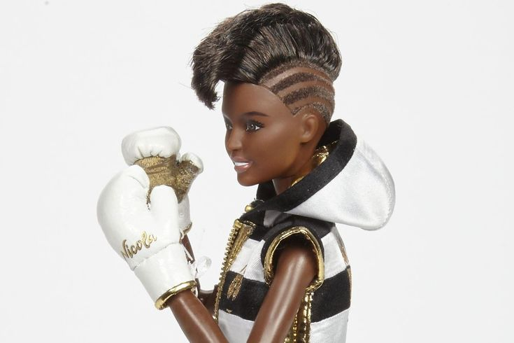 Meet mini-Nicola Adams OBE, the boxer Barbie doll creating a stern contrast to Barbie's classic dolls. A Barbie doll collaboration featuring an Olympic Gold medallist is one we might not have expected. However, the launch of Barbie's 'Shero' programme makes boxing champion Nicola Adams OBE the first ever UK 'Shero' AND boxer Barbie doll.