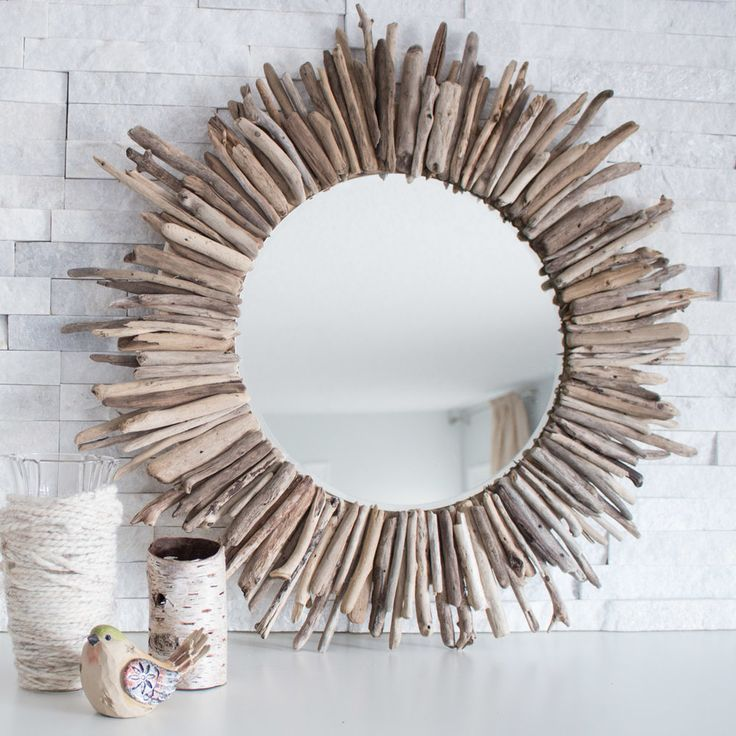 Bring the memories from the beach to your home decor with this DIY project.  Check out the step-by-step tutorial on how to make this easy DIY driftwood  mirror.