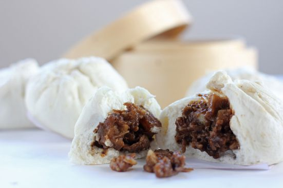 Siopao Asado  Ingredients (Bun) 3 cups dumpling flour + 1/2 cup for dusting 200ml warm water 1/2 cup + 2 tsp white sugar 1/2 tsp salt 1 tbsp shortening or vegetable oil (use shortening to make it whiter in colour) 1 tsp baking powder 1 1/2 tbsp active dry yeast 1/4 cup lukewarm water  (Filling) 400g pork loin, cubed 2 tbsp soy sauce 2 tbsp hoisin sauce 2 tbsp brown sugar 2 tbsp cornstarch, dissolved in 1/3 cup water 4 cloves garlic, minced 1 tsp Chinese five spice powder 1 cup water oil salt