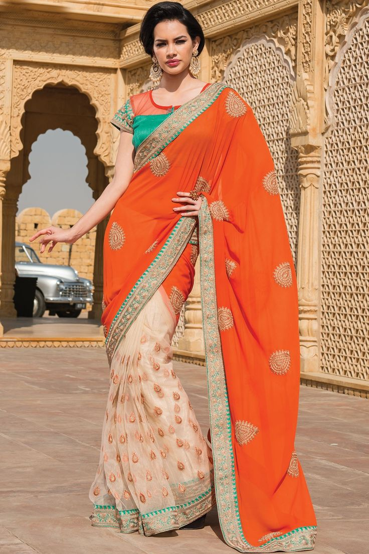 Classy #White Thread worked #Net & #Georgette combo designer saree in #orange thread worked pallu & #peacock blue saree border along with Peacock Blue & Orange plain raw #silk blouse