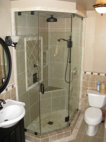 Like the bench, overhead and free showerheads and glass doors, don't like the tile choice.