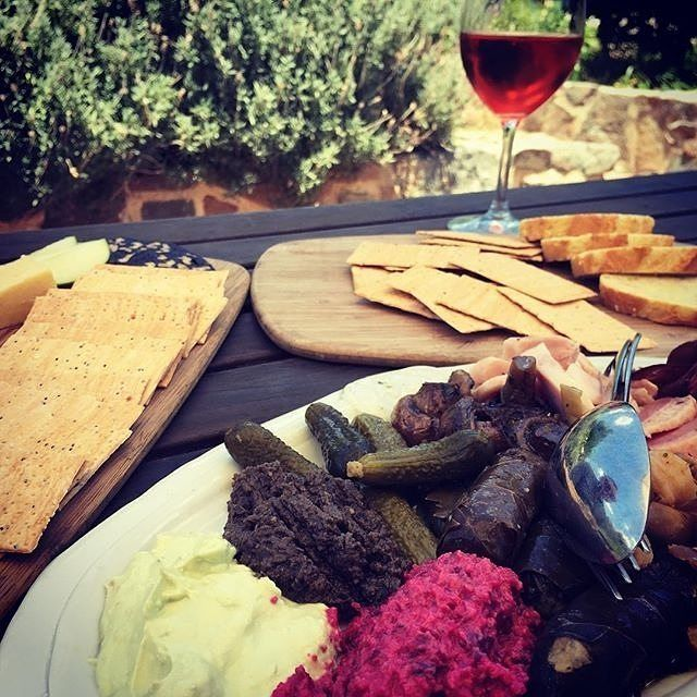 """""""This is what lazy summer Sundays are all about."""" Instagrammer @adam.eats is onto something with this delicious charcuterie, cheeseboard and @wilytrout_vineyard wine from @poacherspantry in Murrumbateman. #visitcanberra"""