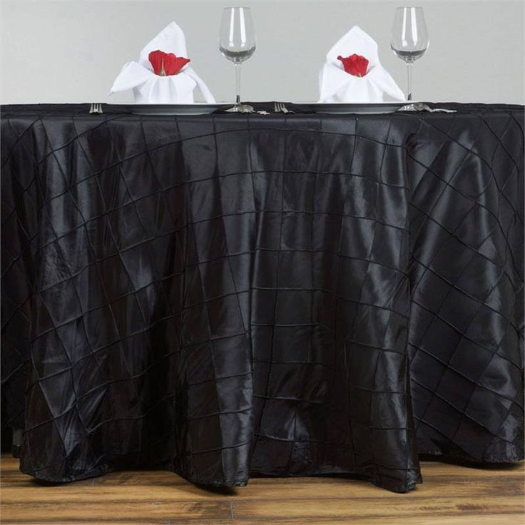 """Black Pintuck Tablecloths 120"""" Round - Pintuck is actually a fold of fabric that is stitched intricately to hold it in a place, very much like a pleat. These lovely pleats impart a decorative effect to the fabric by fashioning a visual line at a chosen point. They effortlessly bridge vintage and contemporary styles to create a majestic new classic look. If you do not want your celebration to blend in with other weddings, birthdays, and anniversaries, try our premium quality pintuck…"""