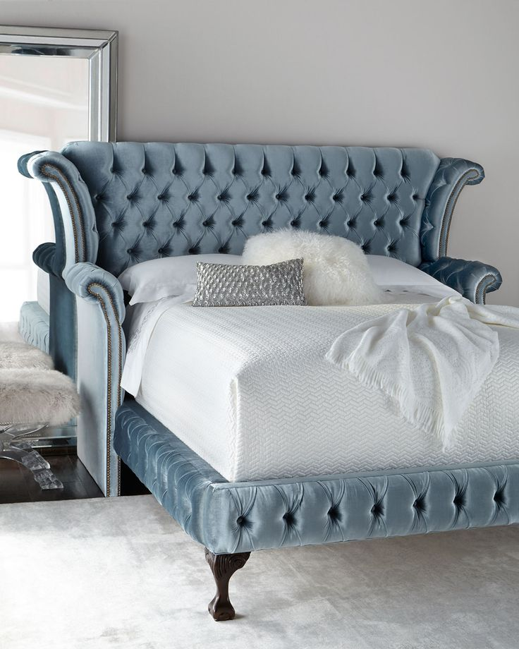"""#ONLYATNM Only Here. Only Ours. Exclusively for You. Handcrafted bed. Alder wood frame. Polyester velvet upholstery with golden nailhead trim. 93""""W x 89""""L x 61""""T. Arms, 39""""T; rails, 18""""T. Assembly req"""