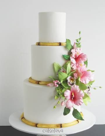 Handcrafted Hibiscus and orchids cake with bamboo by Rick Reichart, cakelava. www.cakelava.com