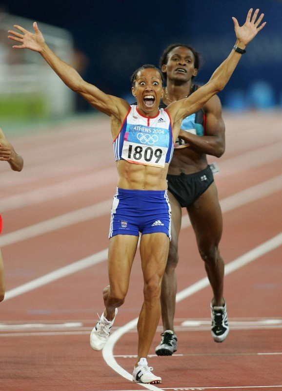 "Dame Kelly Holmes - An exceptional schoolgirl athlete, Holmes turned her back on an athletics career & joined the British Army. She still competed, often against men, then returned to athletics in '92. Performing well, but never quite delivering. A 10-year cycle of injury, recovery & brief success pushed her into clinical depression & self-harm. In Athens she was uninjured & fought from the back in both races to take gold. ""I achieved my goals after 20 years of dreaming."" 2004/Athens"