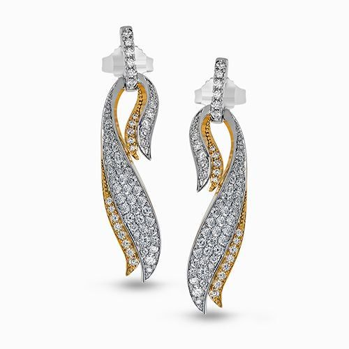 These eye-catching earrings feature a modern two-tone cascade design with .94 ct...