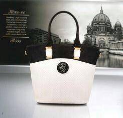 White, black and gold handbag