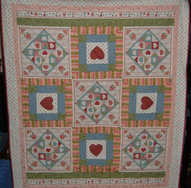 The 5 'blocks' are from a panel & the 4 heart blocks were made by me!....another quilt for Mum!