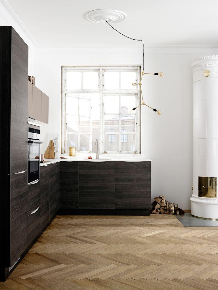 kitchen: large window, wood stove, wood floor | Dark Wood by Kvik