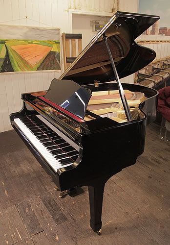 A 1975, Yamaha G2 grand piano for sale with a black case and spade legs at Besbrode Pianos. Piano has some scratches to the polyester on cabinet which is reflected in the price. Piano has an eighty-eight note keyboard and a two-pedal lyre £6500