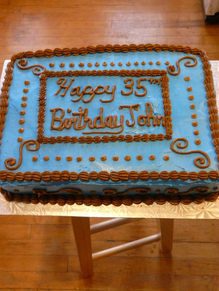 Male 35th Birthday Cake - Birthday cake decorated in masculine colors. Darn good chocolate cake recipe with chocolate pudding filling. All butter cream icing.