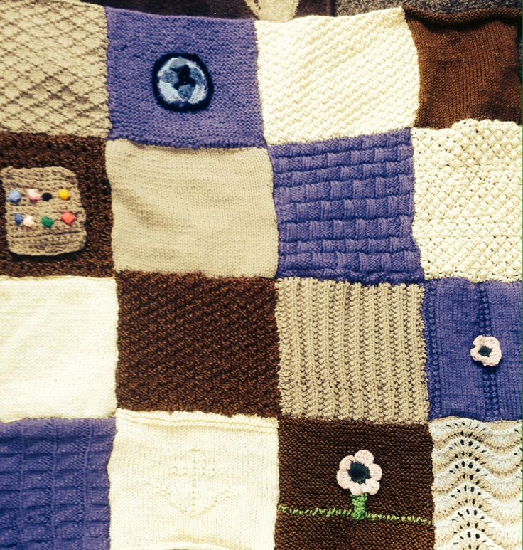 I made a blanket using a limited range of colours, with different stitches to create new textures. I added some crocheted motifs.