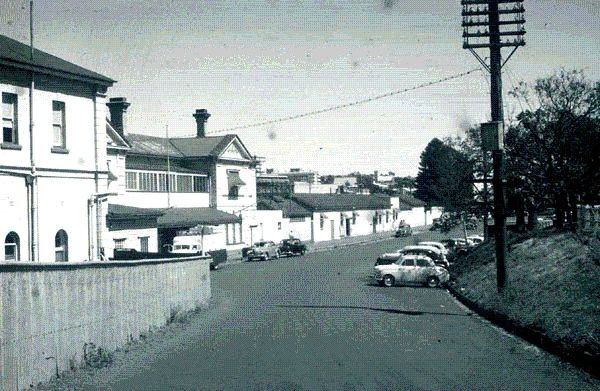 This view of the Toowoomba station (depot in US) was taken from the northern side, looking south, about 1961. The buildings were built of red brick. At the time this photo was taken, the whole exterior was white-washed.  The building on the immediate left housed offices, the central building belonged to the station master, waiting rooms, and the refreshment rooms. The low buildings further away were lavatories, parcels offices, and porters rooms.