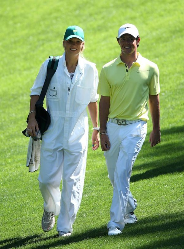 Caroline Wozniacki caddying for Rory McIlroy at the #masters 2013 in Augusta, GA.