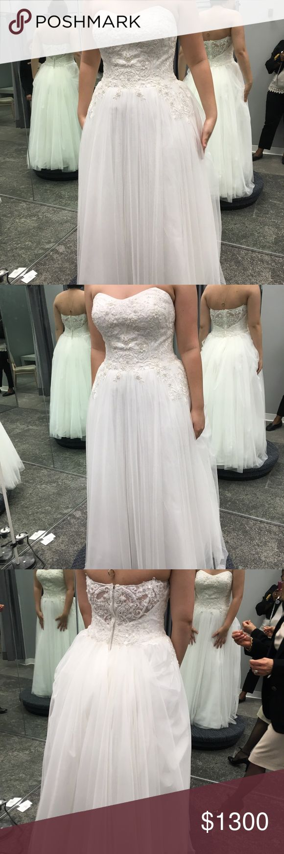 Wedding Dress Davids Bridal NEVER USED wedding dress. Size 14 fits like a 12. Bought in Jan 2017. Has been hanging in Water Proof Garment Bag this whole time. Oleg Cassini Other