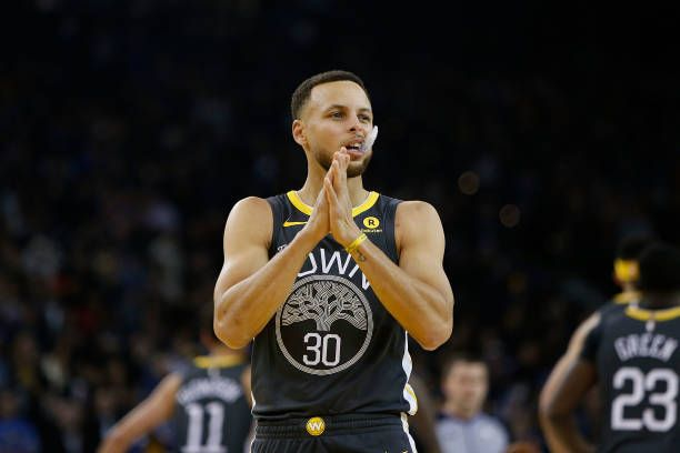 Stephen Curry of the Golden State Warriors looks on before the start of the game against the Los Angeles Clippers at ORACLE Arena on February 22 2018...