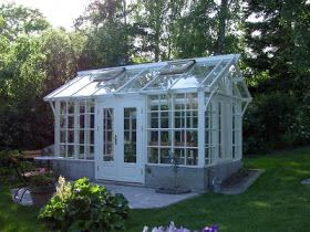 Greenhouse made from old windows. Absolutely beautiful!