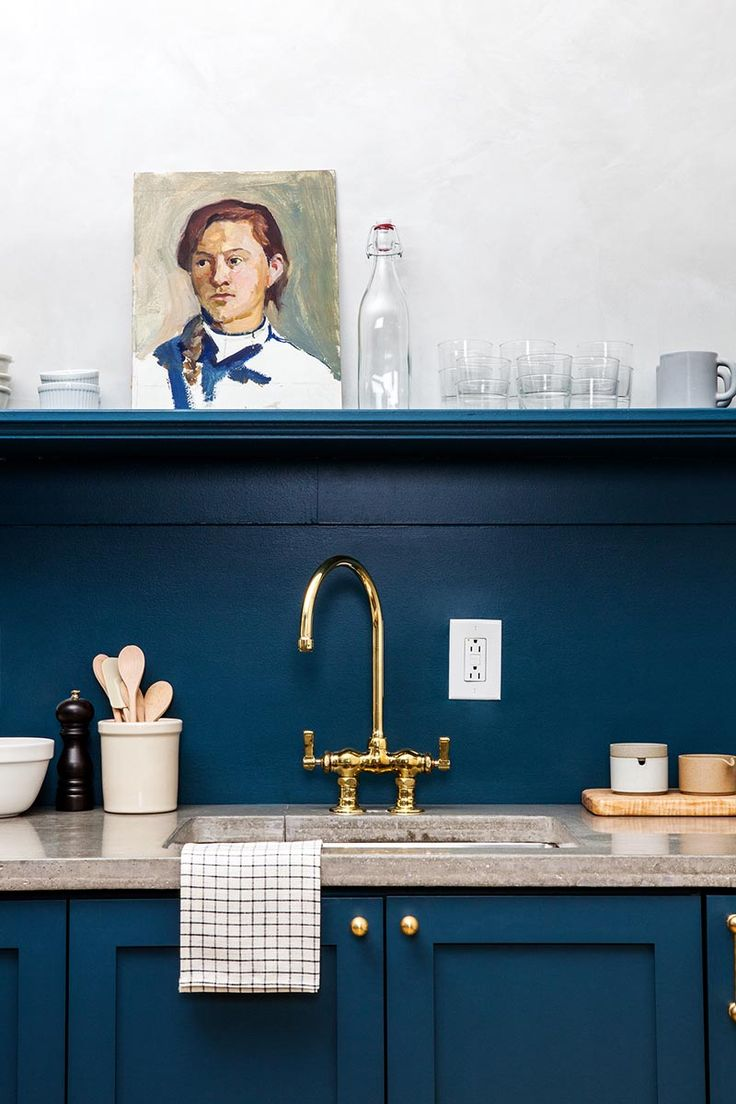 A blue kitchen in Lokal Hotel. Design firm Jersey Ice Cream Co. used Sherwin Williams' Seafaring for the cabinets and backsplash.