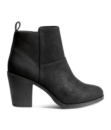 Black. Ankle boots in grained imitation leather with zip at side and loop at back. Fabric lining, fabric insoles, and rubber soles. Heel height 3 1/4 in.