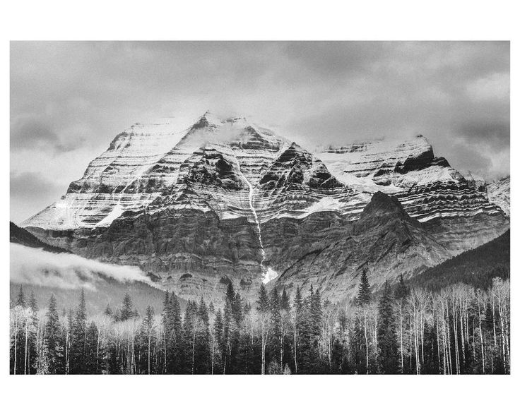 Mount Robson in fog and clouds.  Yellowhead Highway British Columbia