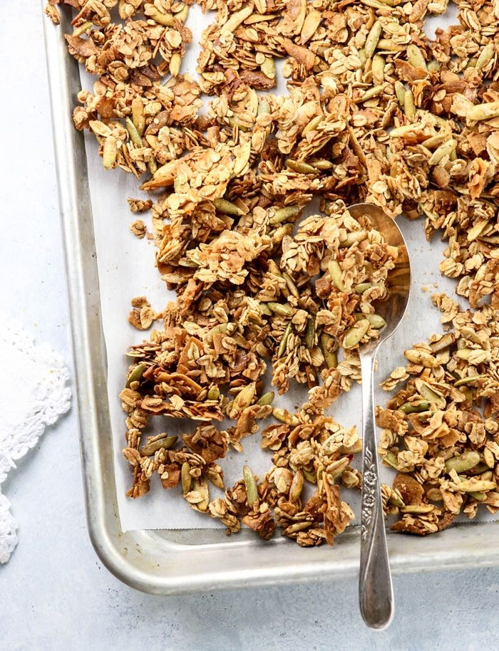 This healthy granola recipe is gluten-free, oil-free, and nut-free. It makes a great breakfast or snack on the go, and takes 30 minutes to prepare!