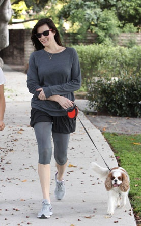 Tyler and her spaniel are all smiles during a leisurely walk in Los Angeles.