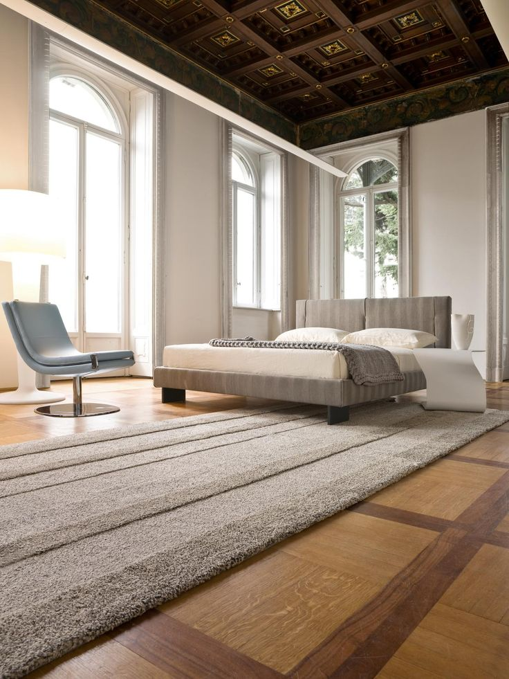 The Two Toned Wood Grid Flooring Adds Dimension And Style To This  Minimalist Neutral Bedroom