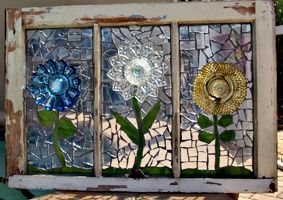stained glass flowers mosaic in an old window - love it!