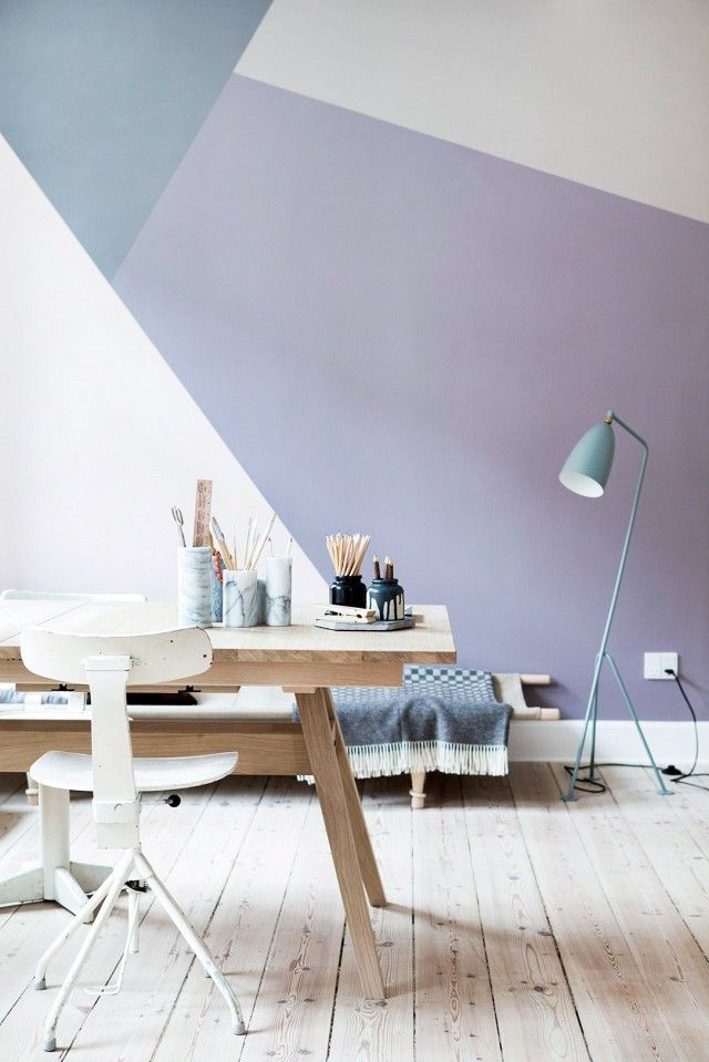This bold graphic wall was painted in muddy grayed-out tones of pink and grey to keep with the minimal Scandinavian feel present throughout the room.