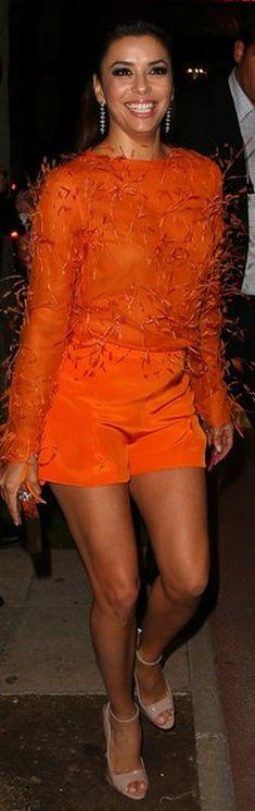 Eva Longoria: Shirt and short – Emilio Pucci  Shoes – Brian Atwood  Jewelry – Chopard
