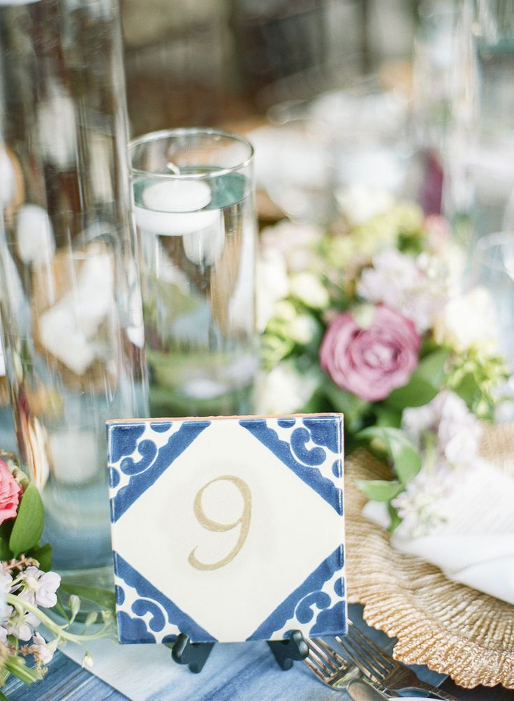tiled table numbers - photo by Lisa Blume Photography http://ruffledblog.com/destination-wedding-in-a-puerto-rican-rainforest