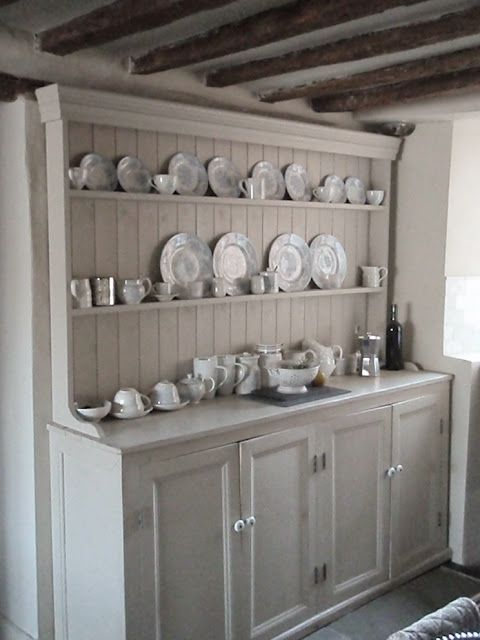 Love the hutch - what a showcase! You wouldn't have to paint it white- natural wood, or a barn red or something would be really nice, too :)