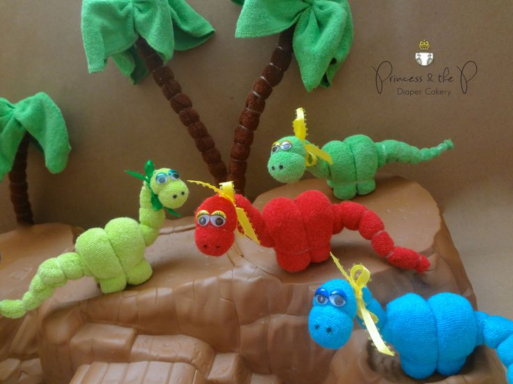 Each baby washcloth Dinosaur is handcrafted from 2 soft Terry baby washcloths 9x9. They make Perfect Dinosaur baby shower decorations,